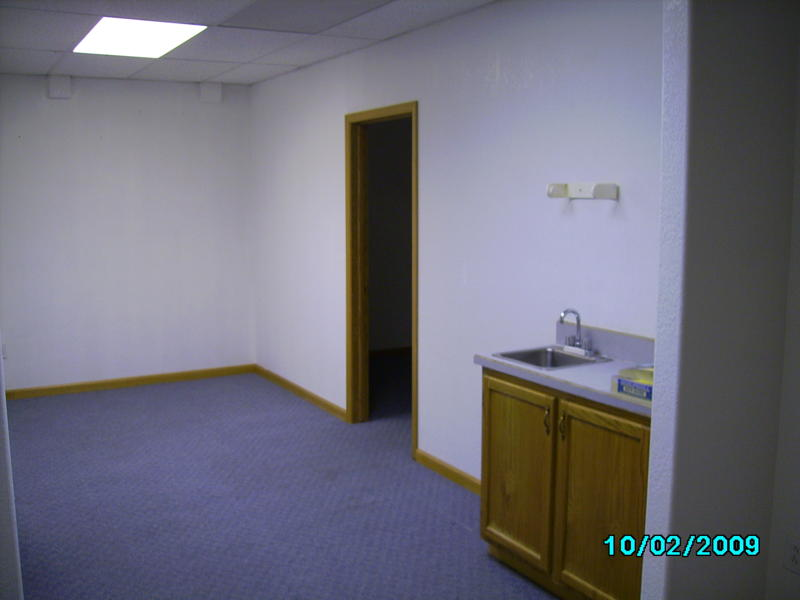 The space was expanded to connect with two other rooms for Office wet bar